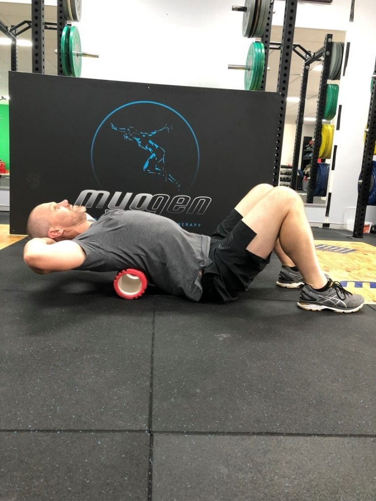 Antony Choice, Director and Soft Tissue Therapist at Myogen, demonstrating a foam roller stretch.